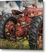 Abandoned Old Farmall Tractor In A Grassy Field Metal Print