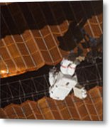 An Astronaut Anchored To A Foot Metal Print