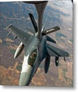 An F-16 Fighting Falcon Receiving Fuel Metal Print