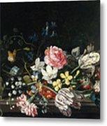 An Overturned Vase Of Flowers Resting On A Ledge Metal Print