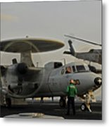 An Sh-60f Sea Hawk Helicopter Lifts Off Metal Print