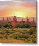 Ancient Pagodas In The Countryside From Bagan In Myanmar At Suns Metal Print