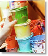 Artist Reaching For A Liquid Paint Container. Metal Print
