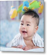 Asian Newborn Baby Smile In A Bed With Fish And Animal Mobile Metal Print