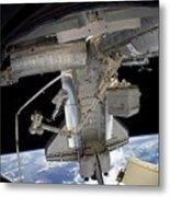 Astronaut Participates In A Spacewalk Metal Print
