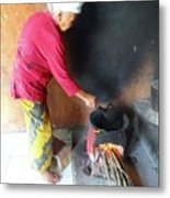 Balinese Lady Roasting Coffee Over The Fire Metal Print