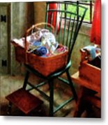 Basket Of Cloth And Yarn On Chair Metal Print
