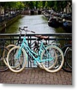 Bicycle Parked At The Bridge In Amsterdam. Netherlands. Europe Metal Print