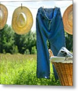 Blue Jeans And Straw Hats On Clothesline Metal Print