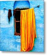 Blue Wall With Orange Sari Metal Print