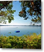 Boat Framed By Trees And Foliage Metal Print