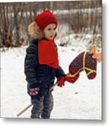 Boy On A Toy Horse Is Standing On The Street In Winter Metal Print