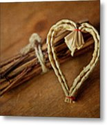 Braided Wicker Heart On Small Bundled Wood Metal Print