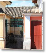 Brick House With Iron Gate Metal Print