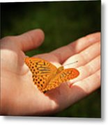 Butterfly On A Childs Hand Metal Print