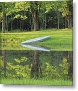 Canoe At Ponds Edge Metal Print