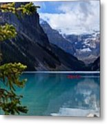 Canoe On Lake Louise Metal Print by Larry Ricker