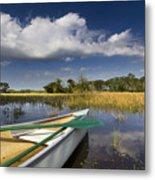 Canoeing In The Everglades Metal Print by Debra and Dave Vanderlaan