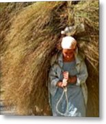 Carrying The Hay Metal Print