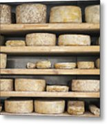 Cheese Wheels On Wooden Shelves In The Cheese Store Metal Print