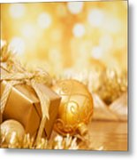 Christmas Scene With Gold Baubles And Gift On A Gold Background Metal Print