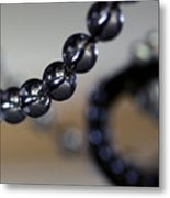 Close-up View Of A String Of Beads Metal Print