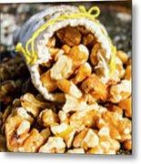 Closeup Of Walnuts Spilling From Small Bag Metal Print