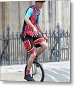 Clown Riding Unicycle In Town Metal Print
