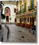 Cobblestone Argote De Molina Street With Cafe Ending At The Nort Metal Print