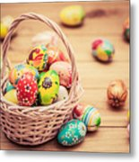 Colorful Hand Painted Easter Eggs In Basket And On Wood Metal Print