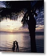 Couple Silhouetted On Beach Metal Print