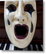 Crying Mask On Piano Keys Metal Print
