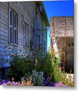 Dahmen Barn Flowers Metal Print