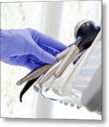 Dentist Picking Dental Instruments In Dentist's Office Metal Print