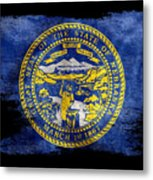 Distressed Nebraska Flag On Black Metal Print