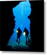 Divers Silhouetted Through Reef Metal Print