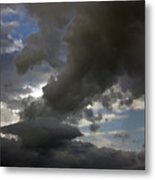Dramatic Storm Clouds Against A Background Of Blue Sky Metal Print
