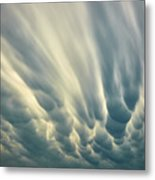 Dropping Clouds Metal Print