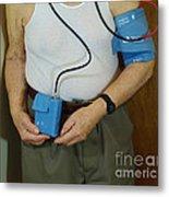 Elderly Man Wearing A Blood Pressure Metal Print