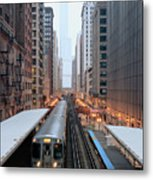 Elevated Commuter Train In Chicago Loop Metal Print by Photo by John Crouch