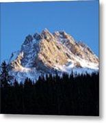 Fading Afternoon Sun Illuminates Mountain Peak  Metal Print