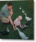 Feeding Ducks With Daddy Metal Print