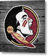 Florida State University Seminoles Logo On Weathered Wood Metal Print