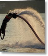 Flyboarder About To Enter Water With Hands Metal Print