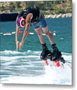 Flyboarder Bending Over To Dive Into Water Metal Print