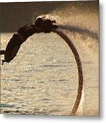 Flyboarder Doing Back Flip Over Backlit Waves Metal Print