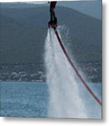 Flyboarder In Silhouette Balancing High Above Water Metal Print