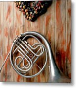 French Horn Hanging On Wall Metal Print
