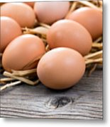 Fresh Organic Eggs On Rustic Wooden Boards And Straw Metal Print