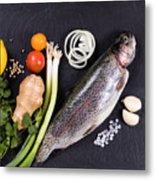 Fresh Whole Raw Fish And Herbs Displayed On Natural Slate Stone  Metal Print
